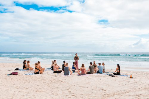 yoga on the beach, people
