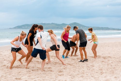 people exercising on beach